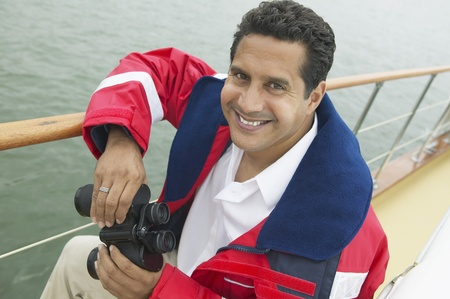 Man Using Binoculars on Yacht Stock Photo - 12513642