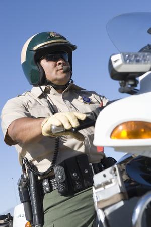 policier: Moto patrouille de la police LANG_EVOIMAGES