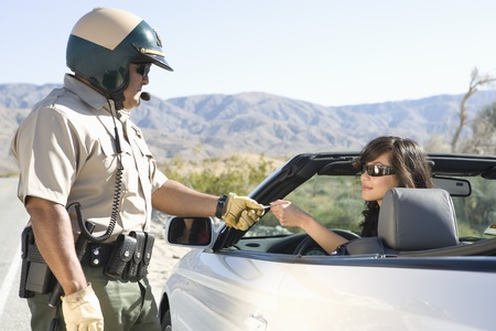 stopping: Highway patrol officer with female driver LANG_EVOIMAGES