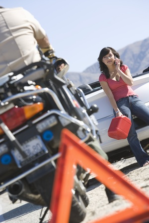 Female driver with petrol canister at roadside Stock Photo - 12513684