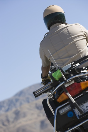 motorcycle officer: Highway patrol officer on motorcycle LANG_EVOIMAGES