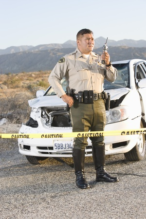 Highway patrol officer at scene of crime Stock Photo - 12513695