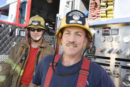 Firefighters and truck Stock Photo - 12513737