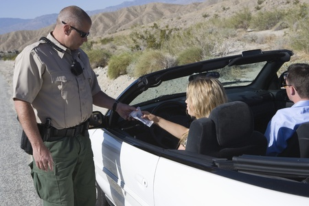 female driver hands papers to police officer Stock Photo - 12513771