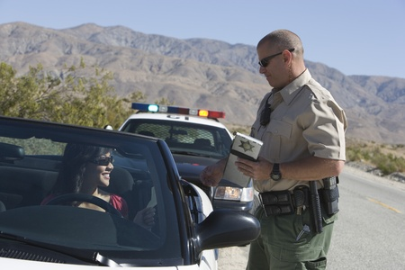 Police officer issuing a ticket