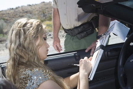 Female driver fills in police details Stock Photo - 12513800