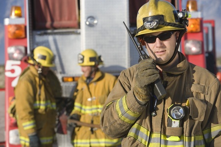 walkie talkie: Firefighter using walkie talkie LANG_EVOIMAGES