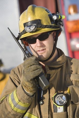 firefighter: Firefighter holding two-way radio