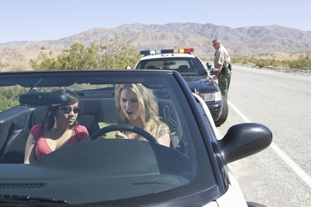 pulled over: Female drivers pulled over by police officer LANG_EVOIMAGES
