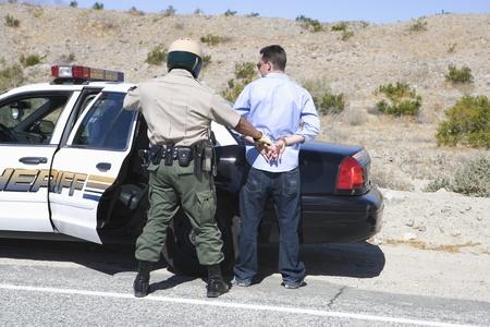 arrests: Police officer arrests male driver