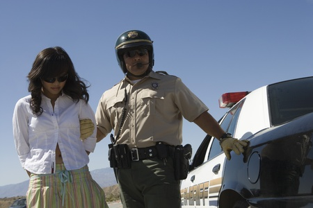 Police officer arrests female driver Stock Photo - 12513815