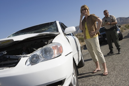 Police man and woman reporting car crash Stock Photo - 12513822