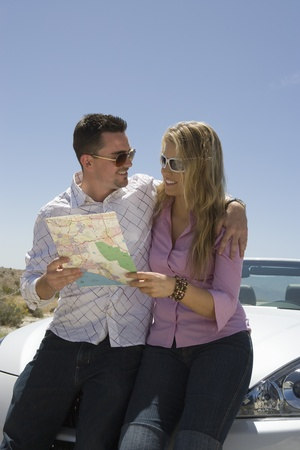 Couple look at map Stock Photo - 12513833