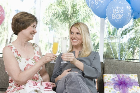 Two Women toasting drinks at a Baby Shower