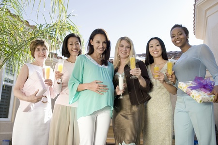 Women standing outside celebrating a Baby Shower Stock Photo - 12513880