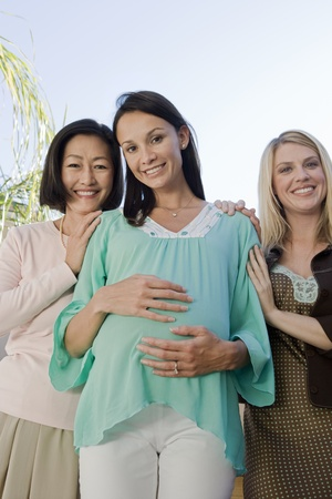 only mid adult women: Women standing outside celebrating a Baby Shower