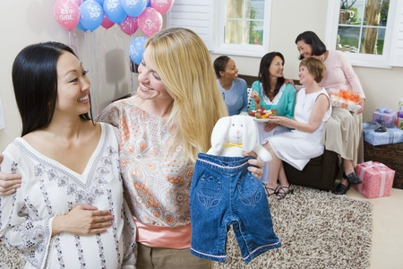 Pregnant Asian Woman with friend at a Baby Shower Stock Photo - 12513900