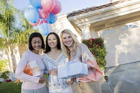 only mid adult women: Pregnant Asian Woman with Mother and Friend at a Baby Shower