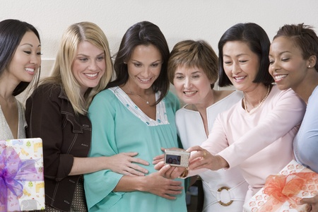 Pregnant Woman with Friends at a Baby Shower Taking Photos Stock Photo - 12513931