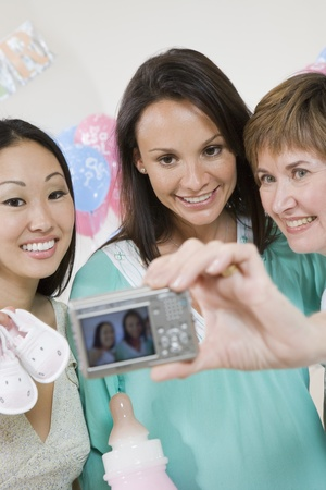 Pregnant Woman with Friends at a Baby Shower Stock Photo - 12513935