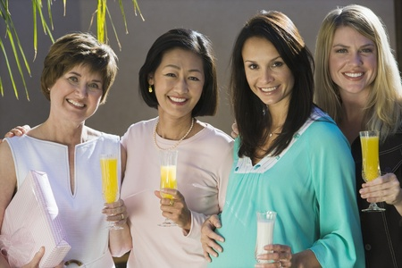 Pregnant Woman with Friends at a Baby Shower Stock Photo - 12513936