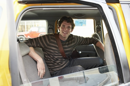Man on Back Seat of Car