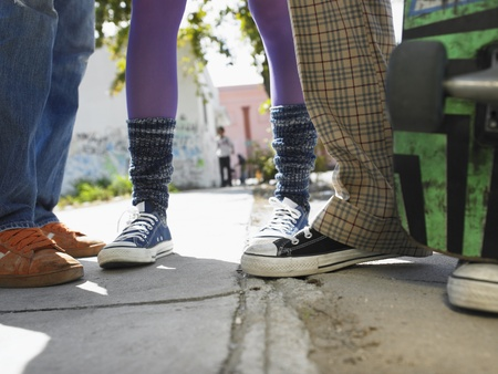 leg warmers: Teenage Friends on Sidewalk