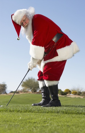 christmas golf: Santa Claus Playing Golf