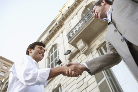 labouring: Two Businessmen Shaking Hands