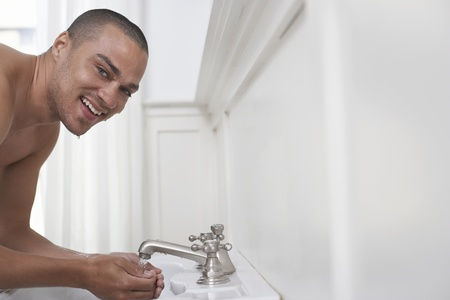 Young Man Washing in Basin Stock Photo - 12513979