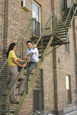 age 25 30 years: Young Couple on Fire Escape