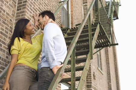 20 to 25 year olds: Young Couple on Fire Escape