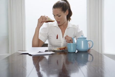 Woman with stain on blouse at dining room table