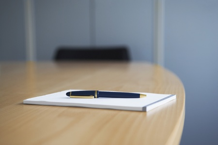 Ballpoint pen and notepad on conference table Stock Photo - 12514000