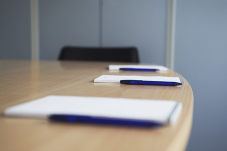 Ballpoint pens and notepads on conference table Stock Photo - 12514001