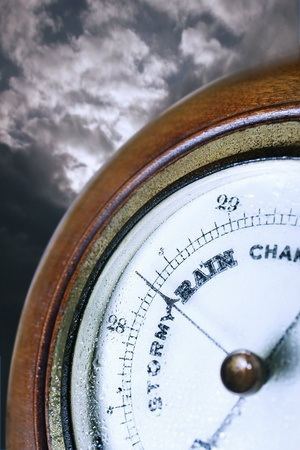Barometer in front of cloudy sky digital composite Stock Photo - 12514050