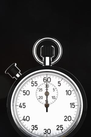 Stopwatch on black background studio shot Stock Photo - 12514056