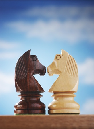 Chess pieces two knights face to face