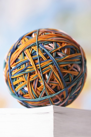 Rubber Band Ball resting on book Stock Photo - 12514070