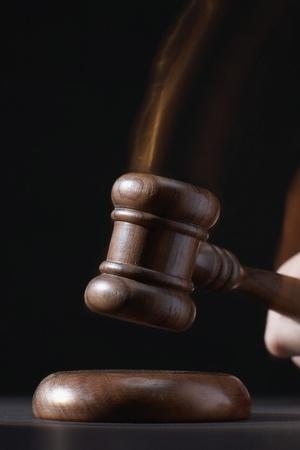 conviction: Gavel hitting base black background