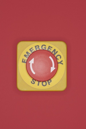 Emergency stop button on red background Stock Photo - 12514088
