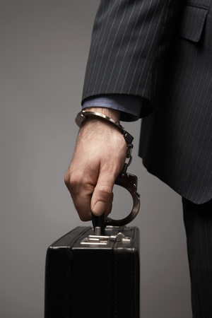 ownership and control: Briefcase Handcuffed to Businessmans Wrist LANG_EVOIMAGES