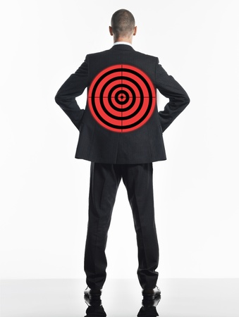 paranoia: Young businessman with target on back back view