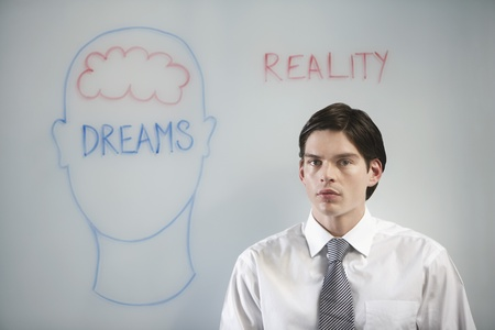 Businessman in front of graphic on whiteboard Stock Photo - 12514142