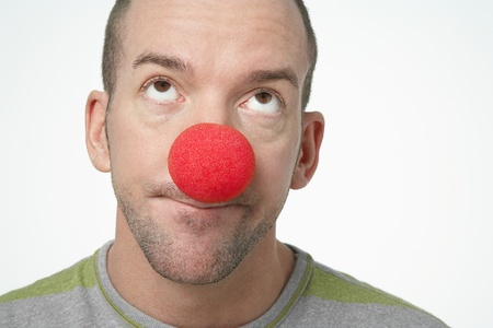 Man Wearing Clown Nose looking upwards in disgust Stock Photo - 12514144