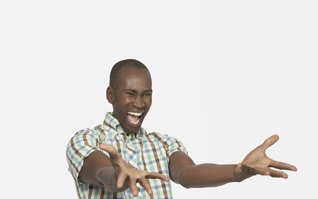 Enthusiastic Man smiling big arms stretched out in front palms up Stock Photo - 12514146