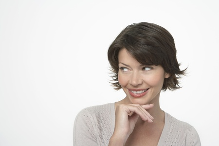 Brunette Woman looking to side hand on chin Stock Photo - 12514150