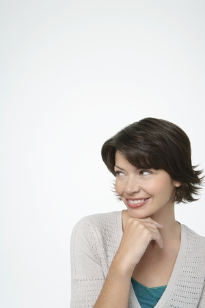 Smiling Woman looking to side hand on chin Stock Photo - 12514152