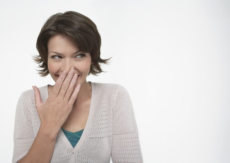 Smiling Woman covering mouth with hand Stock Photo - 12514157