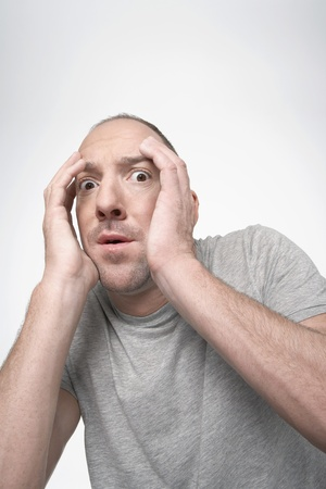 Man hunching down covering face with hands in fear Stock Photo - 12514160
